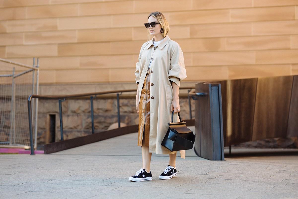 Brooke Testoni wearing Kate Sylvester coat, Wynn Hamlyn skirt, Converse shoes, Celine sunglasses